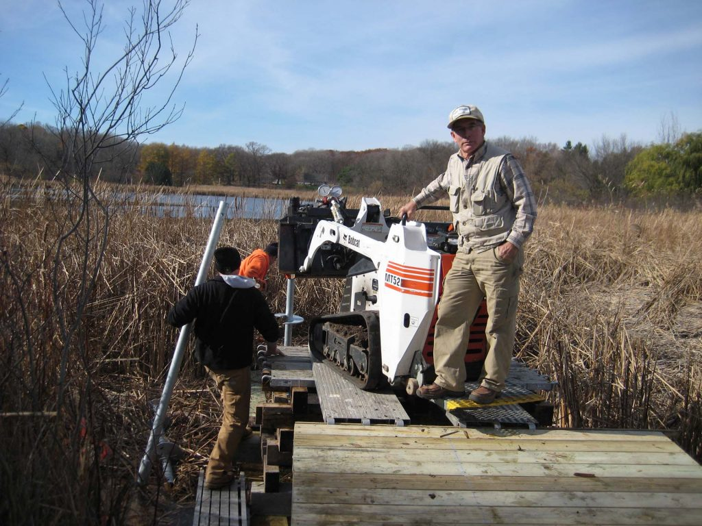 helical pier installation for boardwalk over water