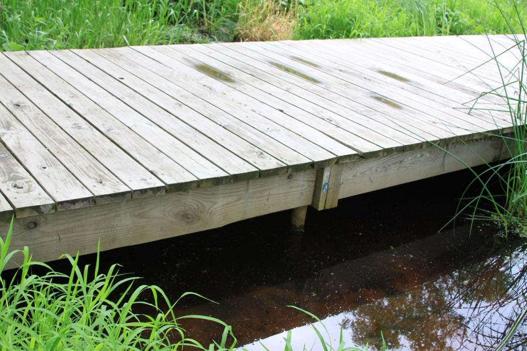 boardwalk over water supported by helical piers
