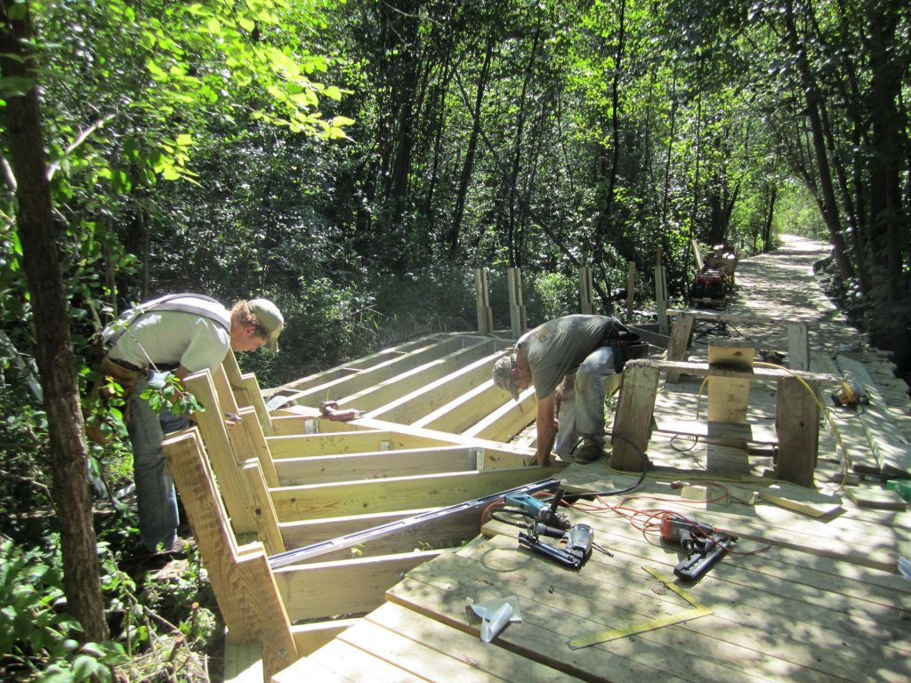 boardwalk seating area under construction suppoted by helical piers